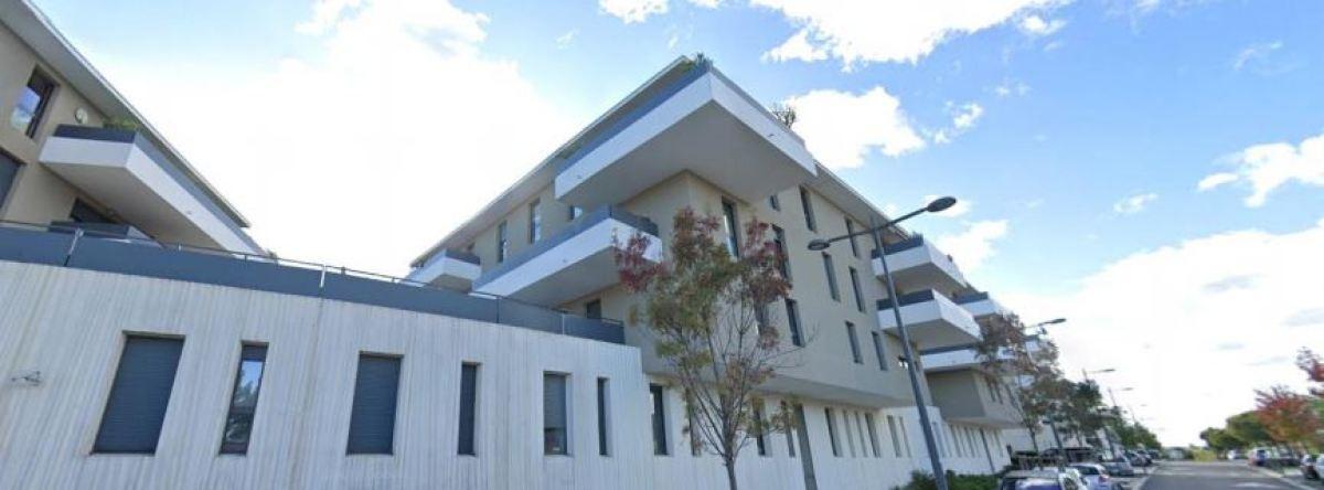 Un immeuble au style contemporain à Juvignac